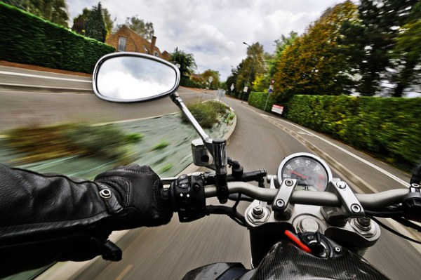 A motorcycle driving down the road from the rider