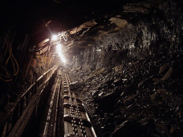 A coal mine showing a light at the end of the tunnel