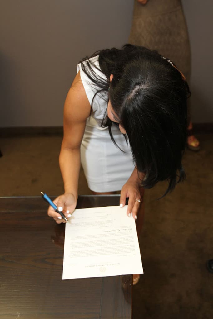 Cassandra Garcia signing her final papers