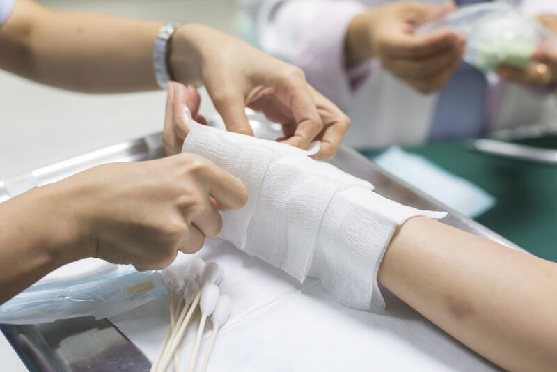 A nurse treats a victim