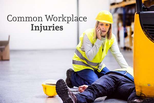 "A female worker in a vest and hardhat kneels over an injured coworker who has been hit by a forklift, calling 911 beside the words ""Common Workplace Injuries"""