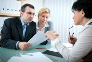 Couple talking to a lawyer about filing a wrongful death claim