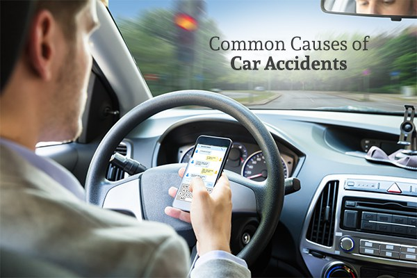 A man texting while driving under the words common causes of car accidents
