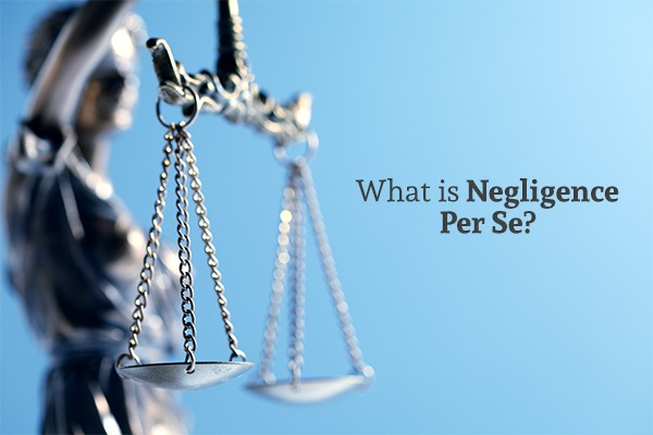 A lady justice statue holding scales beside the words what is negligence per se?