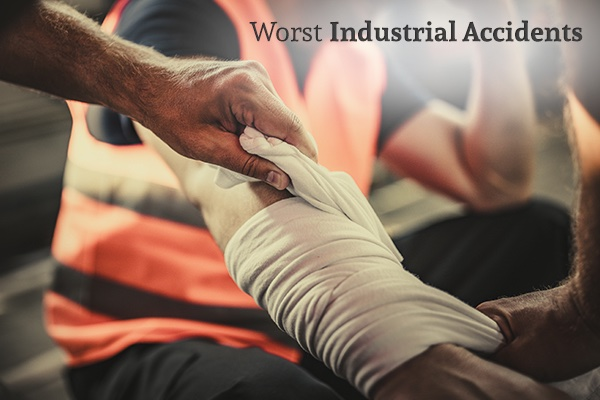 An industrial worker is getting his armed bandaged, with the words, worst industrial accidents.
