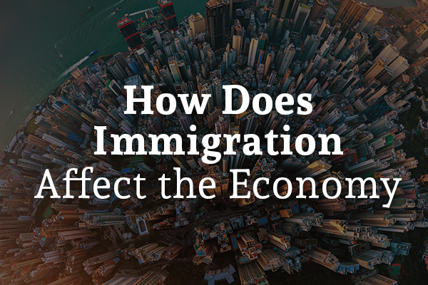 An overview of a city scape with the words, how does immigration affect the economy.
