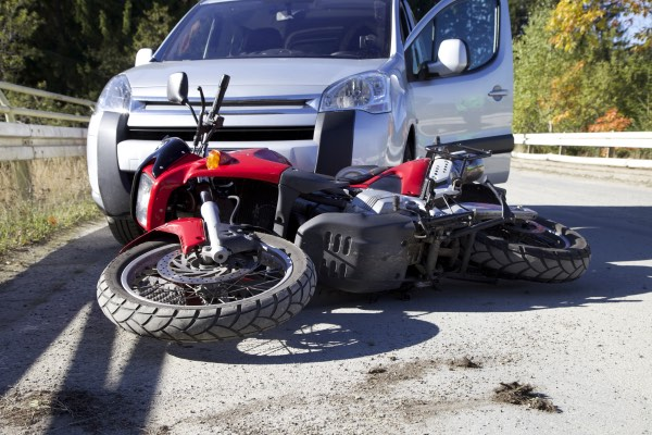 An accident between a motorcycle and a car.