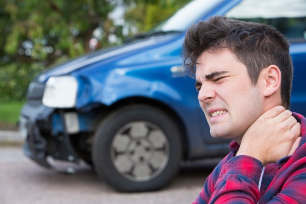 A man is suffering from whiplash after a car accident.