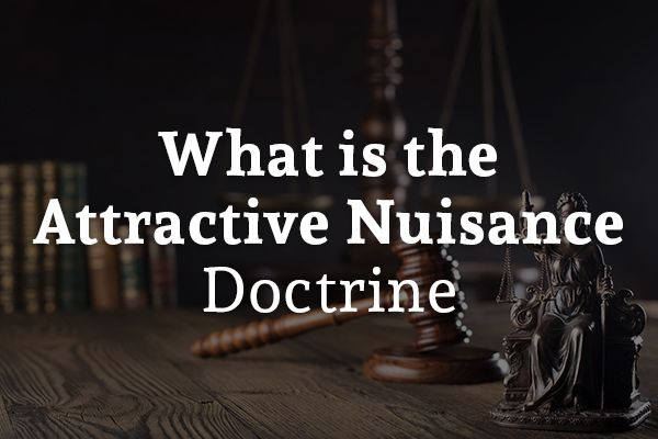 A desk with a gavel and a legal scale with the words, what is the attractive nuisance doctrine