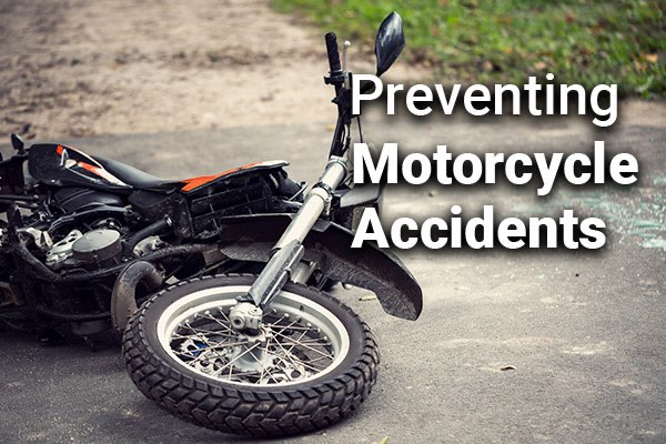 A motorcycle on its side with the words, preventing motorcycle accidents.