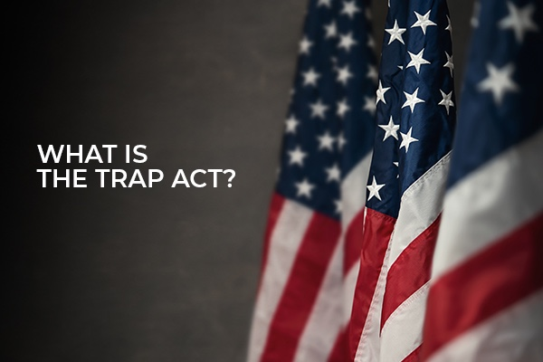 An American Flag with the words, what is the trap act?