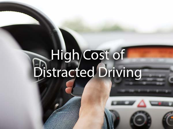 A man checking his phone while driving with the words, high cost of distracted driving.