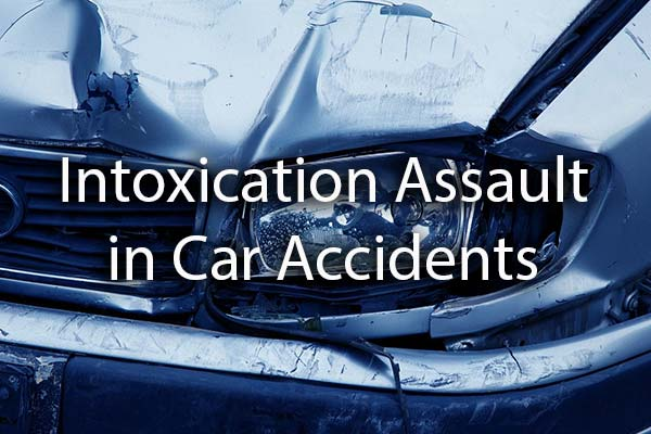 A wrecked car with the words, intoxication assault in Car Accidents